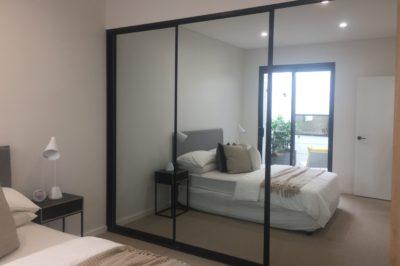 Sliding mirror doors with black aluminium frame - 3 door combination