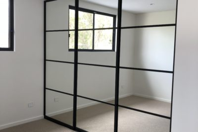 Sliding mirror doors with black aluminium frame with black glazing bars - 3 door combination