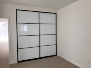 Sliding supa white doors with black aluminium frame and black glazing bars - 2 door combination