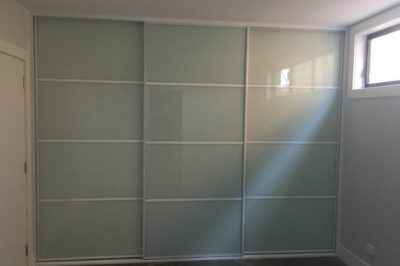 Sliding White Glass Doors with White Glazing Strips
