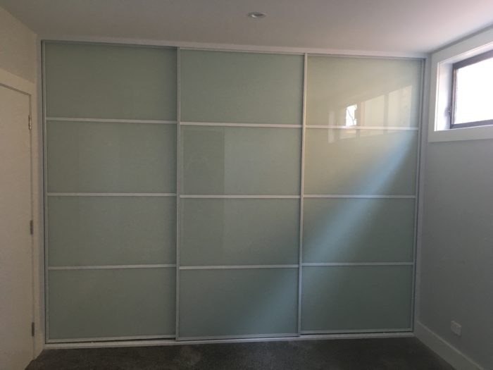 Image 1 Sliding White Glass Doors with White Glazing Strips & Wardrobe Doors - Glass and Mirror - Built in Wardrobes Sydney and ...