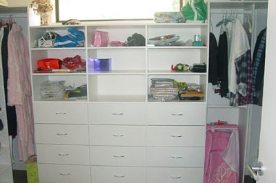 Create a bank of drawers for incredible storage in your walk in wardrobe