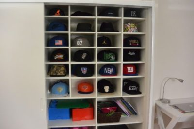 Custom shelves in wardrobe for hat collection