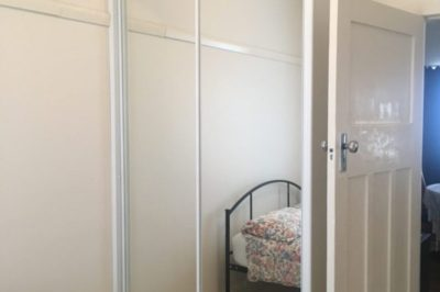 Sliding Mirror Doors with White Frame and Unit Top